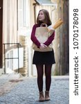 french girl with baguettes on... | Shutterstock . vector #1070178098