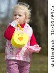 little little girl playing... | Shutterstock . vector #1070179475