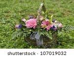 basket with flowers | Shutterstock . vector #107019032
