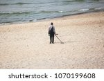 Man On The Beach With A Metal...