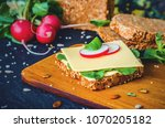 slice of whole grain bread with ... | Shutterstock . vector #1070205182