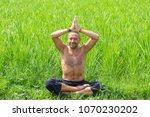 man doing yoga and meditating...   Shutterstock . vector #1070230202