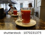 glass of red orange juice on a... | Shutterstock . vector #1070231375