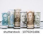 Small photo of Foreign exchange, Forex, currency devalue manipulation game, world major countries banknote roll on chessboard, US, China, india, japan, europe and uk.