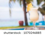glass of delicious pina colada... | Shutterstock . vector #1070246885
