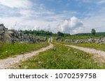 the rural road leads to small... | Shutterstock . vector #1070259758