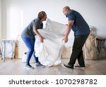 couple moving into new house   Shutterstock . vector #1070298782