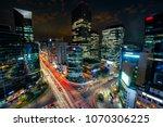 night scene of light trails... | Shutterstock . vector #1070306225