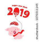 fun pig in a red christmas hat... | Shutterstock .eps vector #1070311145