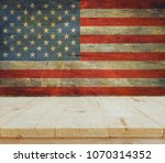 wooden table on usa flag... | Shutterstock . vector #1070314352