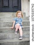 portrait of a happy little girl ... | Shutterstock . vector #1070335742