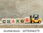 toy yellow forklift hold block... | Shutterstock . vector #1070346275