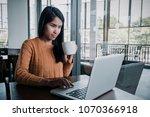 beautiful hipster woman using... | Shutterstock . vector #1070366918