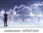 businessman looking at forex... | Shutterstock . vector #1070371535