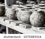 unfinished clay pots on shelves ...   Shutterstock . vector #1070383316