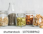 Various Nuts And Seeds In Glas...