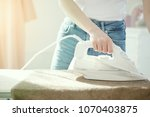 close up hand of woman ironing... | Shutterstock . vector #1070403875