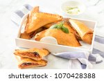 stuffed pizza triangles served... | Shutterstock . vector #1070428388
