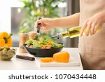 woman dressing fresh vegetable... | Shutterstock . vector #1070434448