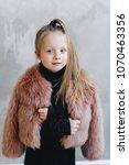model kids.  little girl is... | Shutterstock . vector #1070463356