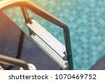 swimming pool with sunny. | Shutterstock . vector #1070469752