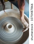 handcrafted on a potter's wheel ... | Shutterstock . vector #1070487866