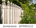 solid privacy vinyl fence  | Shutterstock . vector #1070491112