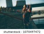 attractive young female runner...   Shutterstock . vector #1070497472