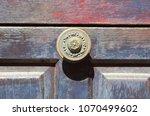 decorative doorknob on an old...   Shutterstock . vector #1070499602