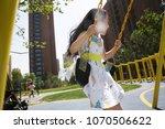 the little girl swings on the... | Shutterstock . vector #1070506622