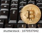 one golden bitcoin on computer... | Shutterstock . vector #1070537042