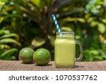 avocado green shake or smoothie ...   Shutterstock . vector #1070537762