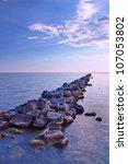 Stones form a bridge to the horizon - stock photo