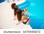 rear shot of three hot ladies ... | Shutterstock . vector #1070540672