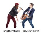 a musical duo of a young couple ... | Shutterstock . vector #1070541845