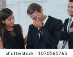young businessman with tears of ... | Shutterstock . vector #1070561765