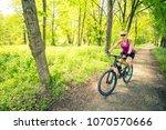 woman cycling a mountain bike... | Shutterstock . vector #1070570666