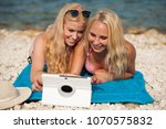 two blonde women having fun... | Shutterstock . vector #1070575832