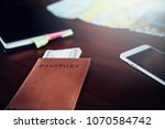 passports and money for travel | Shutterstock . vector #1070584742
