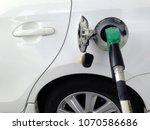 white car fuel filler at fuel...   Shutterstock . vector #1070586686