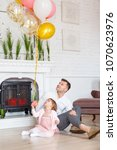 dad and daughter are posing at... | Shutterstock . vector #1070623976