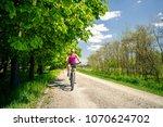 woman cycling a mountain bike... | Shutterstock . vector #1070624702
