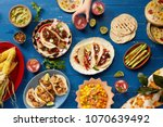 mexican feast served family... | Shutterstock . vector #1070639492