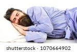sleeps like baby concept. guy... | Shutterstock . vector #1070664902