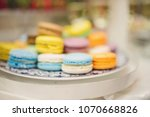 colorful macaroons on plate | Shutterstock . vector #1070668826