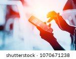 hand using touch screen...   Shutterstock . vector #1070671238