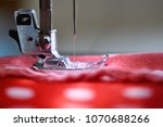 sewing machine foot on material ... | Shutterstock . vector #1070688266