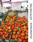 fresh tomatoes in a market | Shutterstock . vector #1070700782