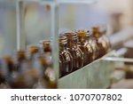 syrup bottles transfer on... | Shutterstock . vector #1070707802