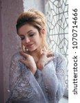 bride in a wedding dress is... | Shutterstock . vector #1070714666